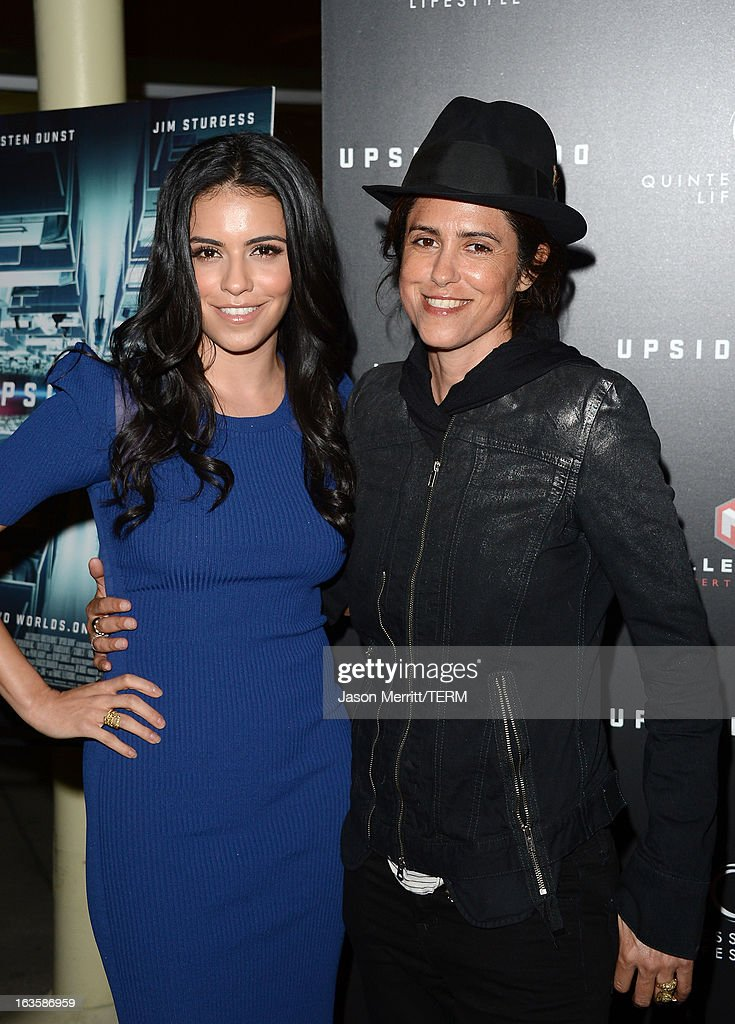 Singer <a gi-track='captionPersonalityLinkClicked' href=/galleries/search?phrase=Francesca+Gregorini&family=editorial&specificpeople=1674677 ng-click='$event.stopPropagation()'>Francesca Gregorini</a> (R) and guest <a gi-track='captionPersonalityLinkClicked' href=/galleries/search?phrase=Olga+Segura&family=editorial&specificpeople=7655907 ng-click='$event.stopPropagation()'>Olga Segura</a> arrive at a special LA screening of Millennium Entertainment's 'Upside Down' at ArcLight Hollywood on March 12, 2013 in Hollywood, California.