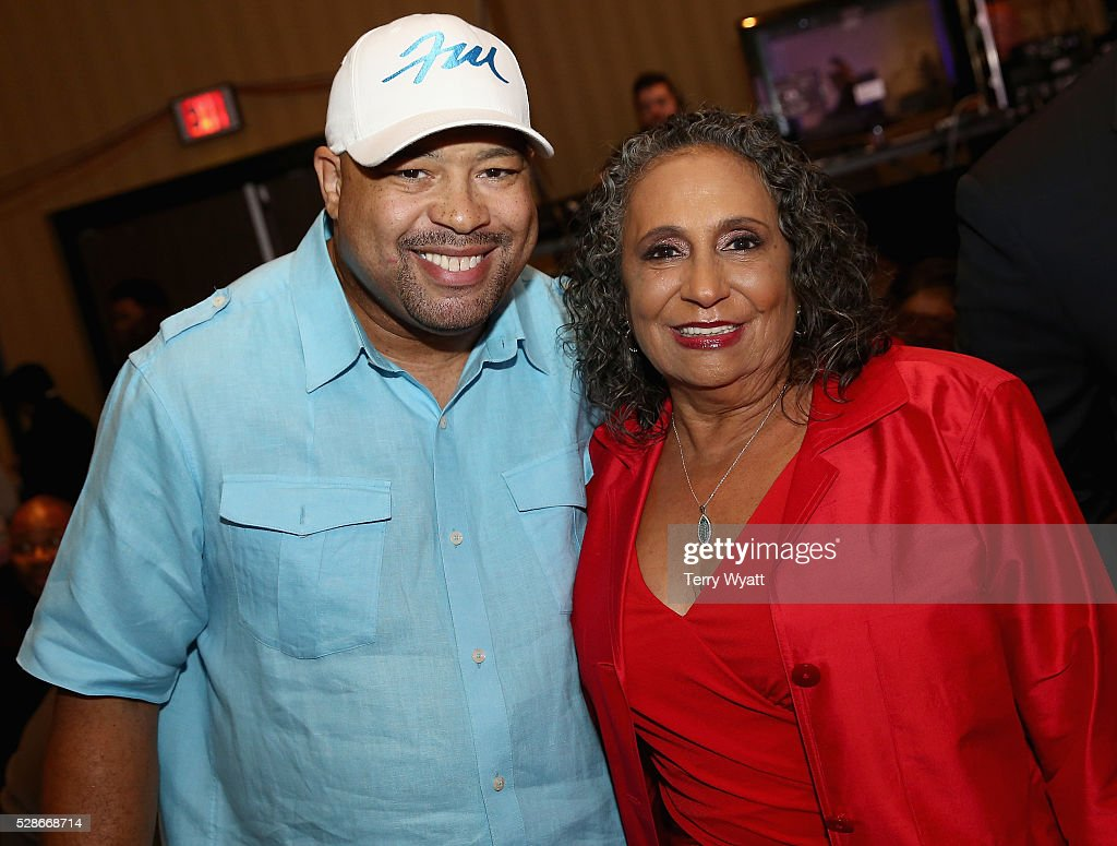 Singer Frank McComb (L) and TV One/Radio One Chairman Cathy Hughes (R) attend NMAAM's Celebration Of Legends Red Carpet And Luncheon on May 6, 2016 in Nashville, Tennessee.