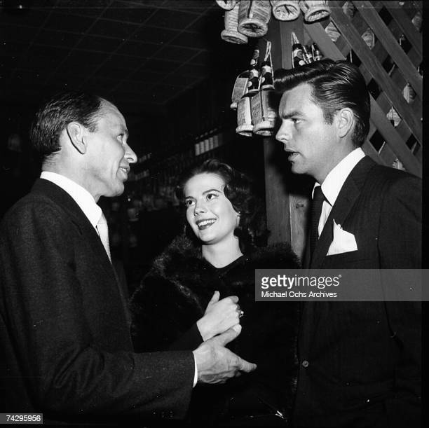 Singer Frank Sinatra attends an event with actress Natalie Wood and actor Robert Wagner in circa 1961 in Los Angeles California