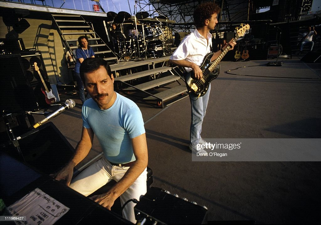 Singer Freddie Mercury and bassist John Deacon of British rock group Queen at a soundcheck Budapest 1986