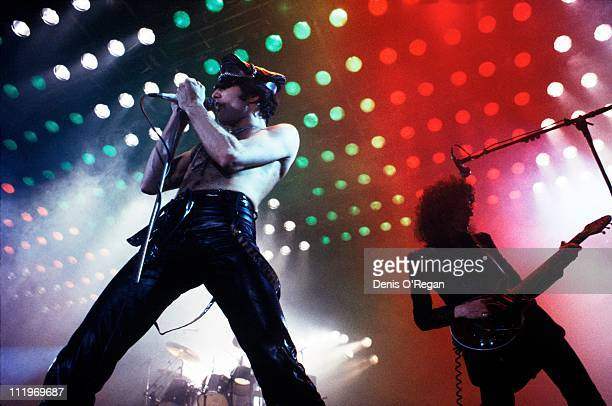 Singer Freddie Mercury and guitarist Brian May performing with British rock group Queen at the Hammersmith Odeon London 1979
