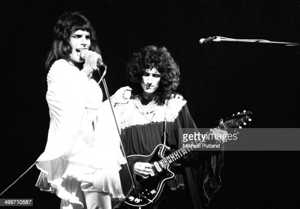 Singer Freddie Mercury and guitarst Brian May of British rock group Queen perform on stage in London 1974