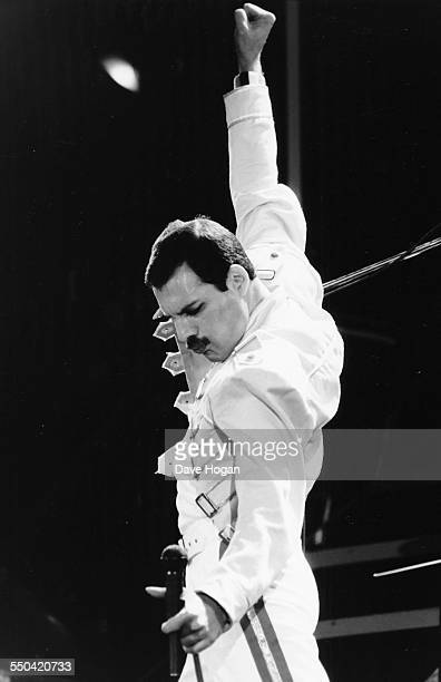 Singer Freddie Mercury his band 'Queen' performing on stage at Wembley Stadium London July 15th 1986