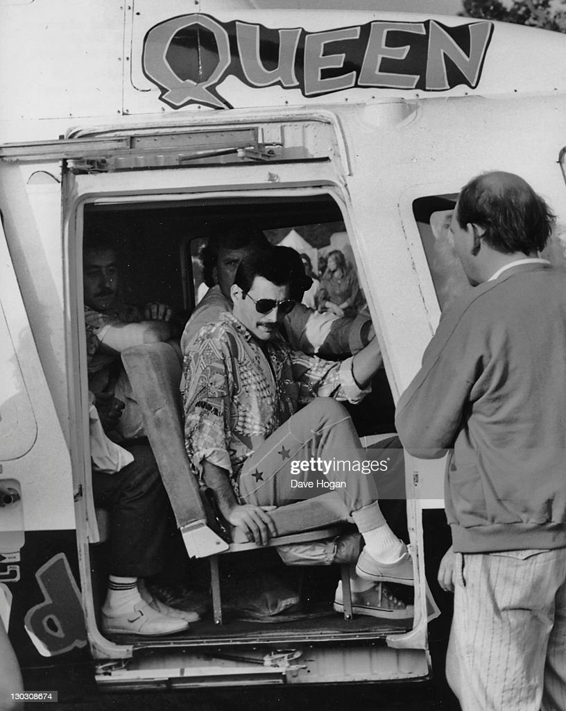 Singer Freddie Mercury of British rock band Queen arrives at the Knebworth Festival by helicopter 9th August 1986