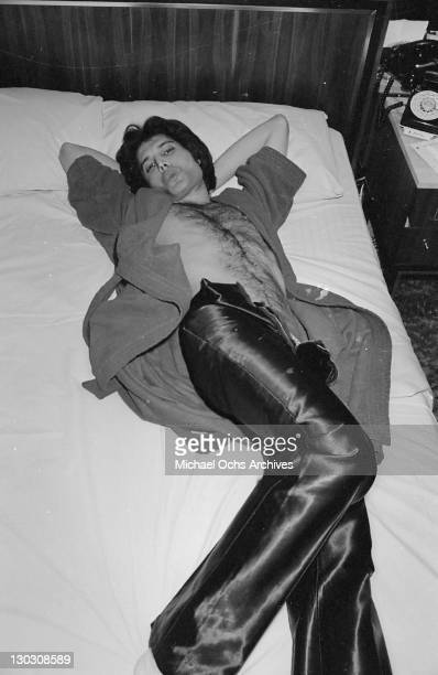 Singer Freddie Mercury of British rock band Queen in a bedroom during a tour circa 1977