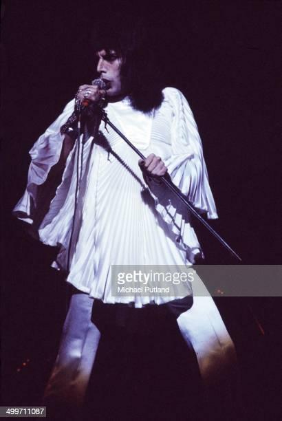 Singer Freddie Mercury of British rock group Queen perform on stage in London 1974