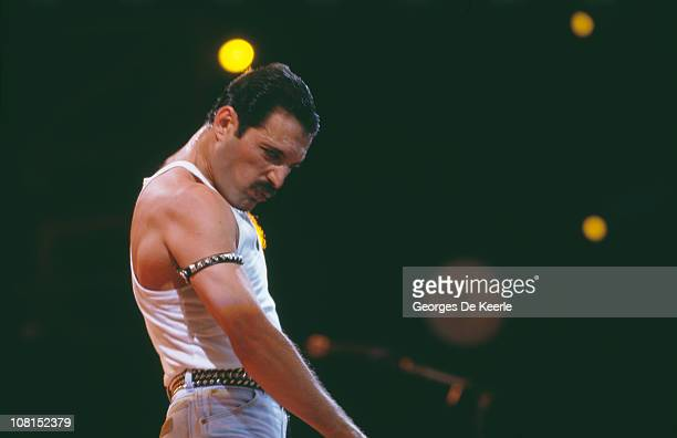 Singer Freddie Mercury of British rock group Queen performing at the Live Aid concert at Wembley Stadium in London 13th July 1985 The concert raised...