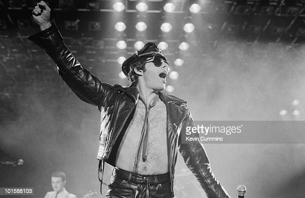 Singer Freddie Mercury of rock band Queen performs on stage at the Apollo in Manchester England on November 27 1979