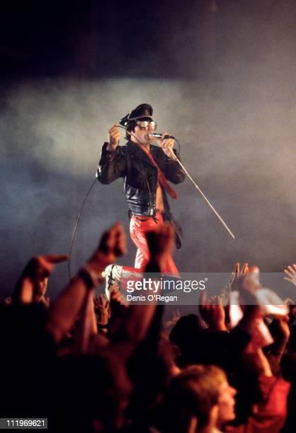 Singer Freddie Mercury performing with British rock group Queen 1979