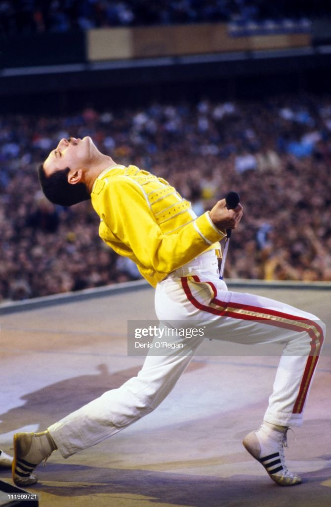 Singer Freddie Mercury performing with British rock group Queen in the UK 1986