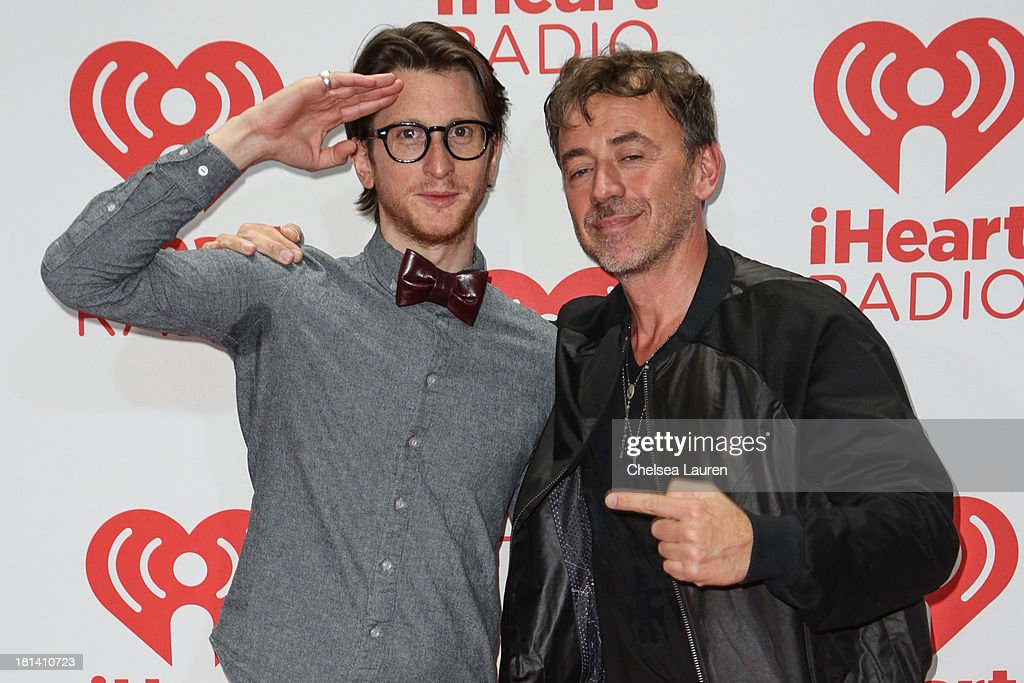 Singer Gary Go (L) and DJ Benny Benassi pose in the iHeartRadio music festival photo room on September 20, 2013 in Las Vegas, Nevada.