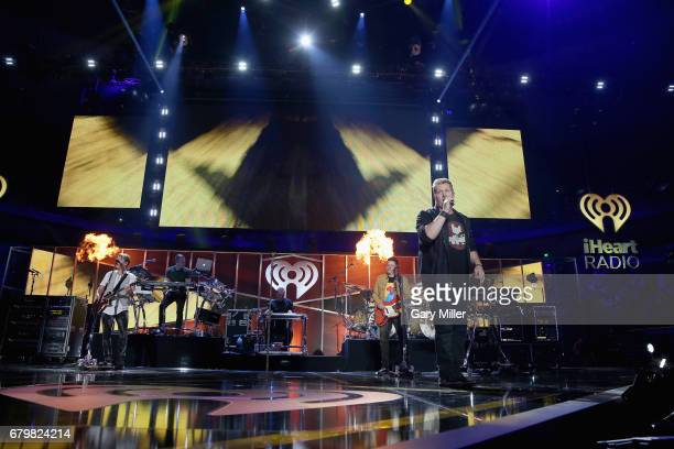 Singer Gary LeVox Joe Don Rooney and Jay DeMarcus of Rascal Flatts perform onstage during the 2017 iHeartCountry Festival A Music Experience by ATT...