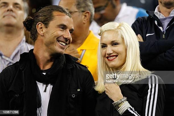 Singer Gavin Rossdale and singer Gwen Stefani attend the men's singles match between Roger Federer of Switzerland and Jurgen Melzer of Austria during...