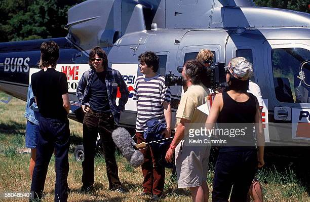 Singer Gaz Coombes and bassist Mick Quinn of English alternative rock group Supergrass are filmed as they arrive at the Glastonbury Festival on a...