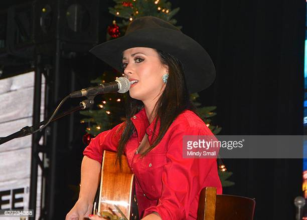 Singer Genevieve Allen performs during the 'Keepin' it Country with Daryle Singletary' show during the National Finals Rodeo's Cowboy Christmas at...