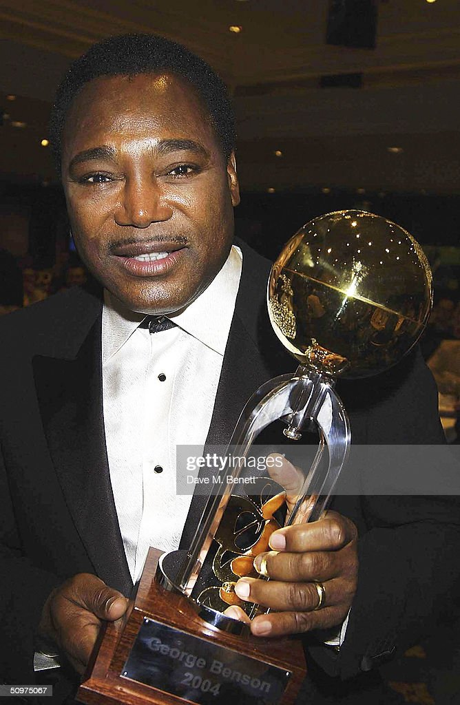 Singer George Benson poses with The Raymond Weil International Award at the Nordoff-Robbins O2 Silver Clef Awards at the Inter-Continental Hotel on June 18, 2004 in London.