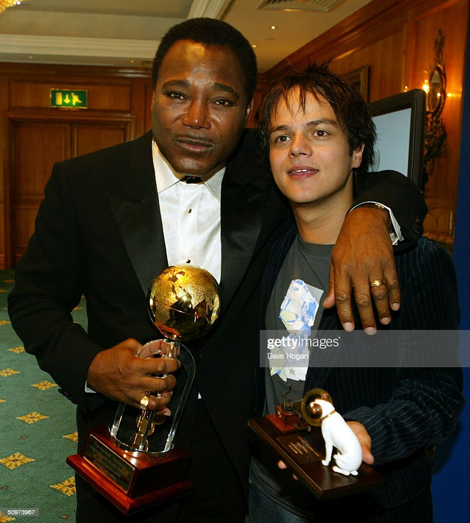 Singer George Benson (L) who won The Raymond Weil International Award poses with Jamie Cullum, winner of the HMV Best New Music award in the pressroom at the Nordoff-Robbins O2 Silver Clef Awards at the Inter-Continental Hotel on June 18, 2004 in London.