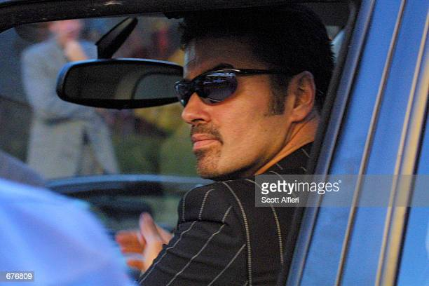 Singer George Michael leaves The Ivy restaurant December 7 2001 in Hollywood CA