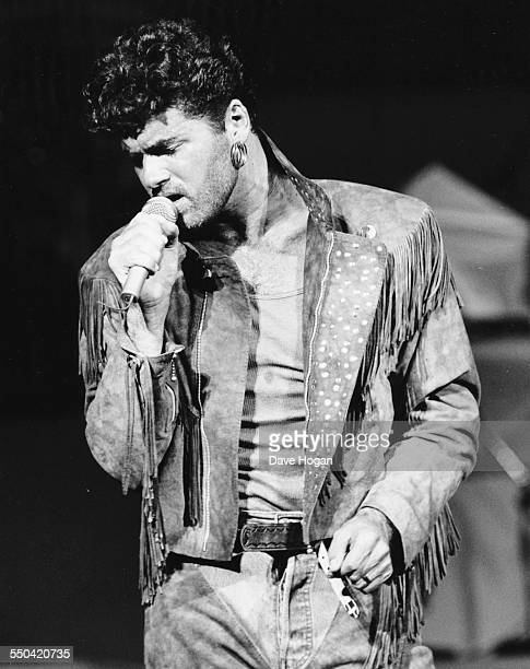 Singer George Michael performing on stage with his band 'Wham' at Brixton Academy in London June 25th 1986