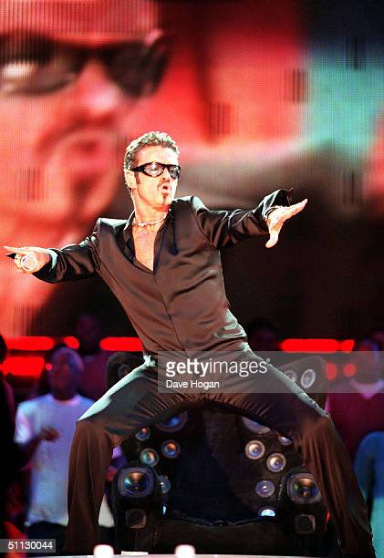 Singer George Michael performs on stage as part of the Net Aid concert on 9th October 1999 at Wembley London