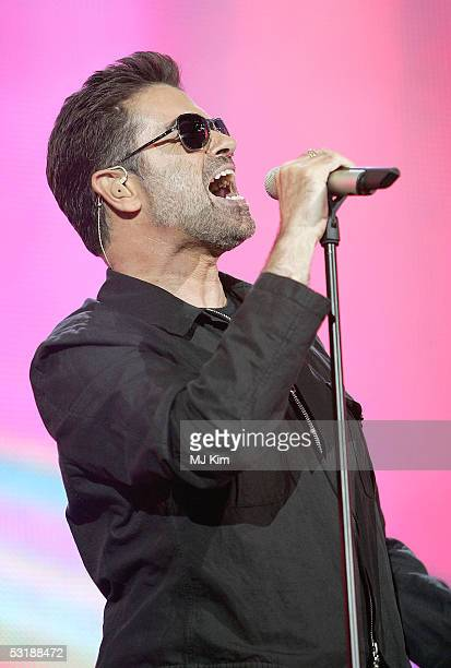 Singer George Michael performs on stage at 'Live 8 London' in Hyde Park on July 2 2005 in London England The free concert is one of ten simultaneous...