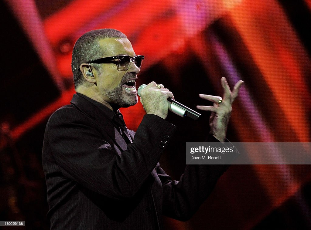 Singer George Michael performs on stage during his 'Symphonica' tour at Royal Albert Hall on October 25, 2011 in London, England.