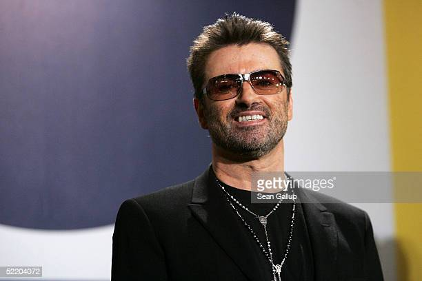 Singer George Michael poses at the 'George Michael A Different Story' Photocall during the 55th annual Berlinale International Film Festival on...