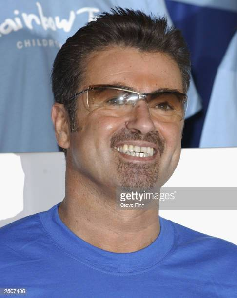 Singer George Michael takes part in a Photocall for 'The Rainbow Trust' Childrens Charity at the Meridien Hotel on September 18 2003 in London