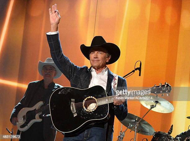 Singer George Strait performs onstage during the 49th Annual Academy of Country Music Awards at the MGM Grand Garden Arena on April 6 2014 in Las...