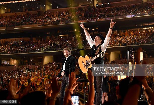 Singer George Strait performs onstage during the 50th Academy of Country Music Awards at ATT Stadium on April 19 2015 in Arlington Texas