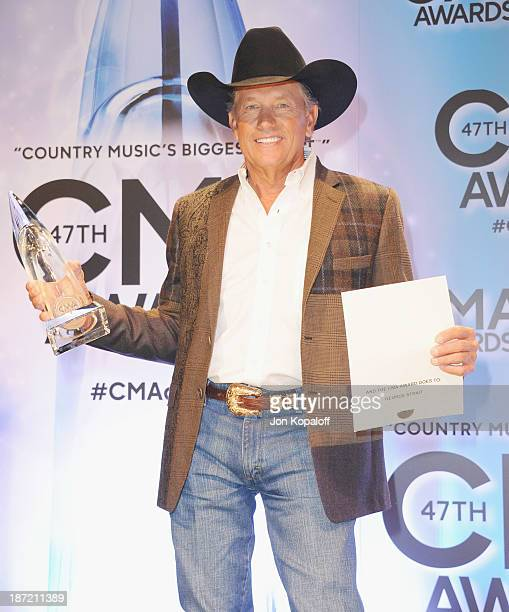 Singer George Strait poses in the press room at the 47th annual CMA Awards at the Bridgestone Arena on November 6 2013 in Nashville Tennessee