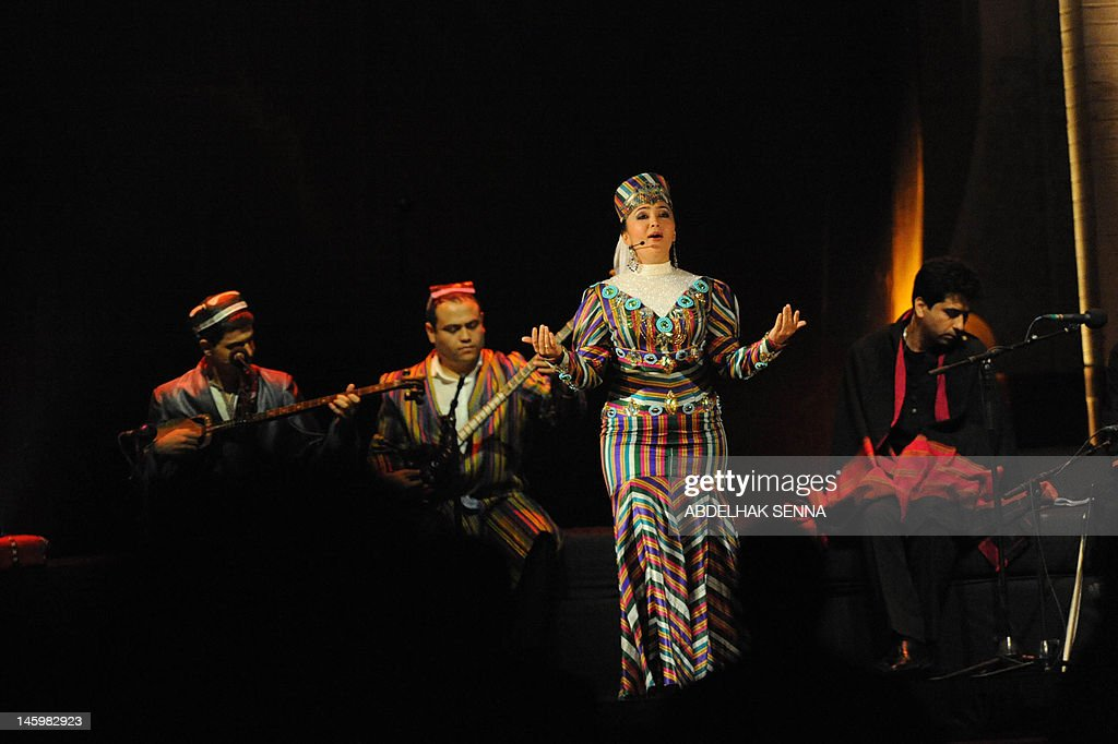 A singer gestures as musicians play during the opening ceremony of the 18th World Sacred Music Festival in Fes on June 8, 2012. They are taking part to a tribute show to Persian poet Omar Khayyam directed by French film director Tony Gatlif. AFP PHOTO/ABDELHAK SENNA