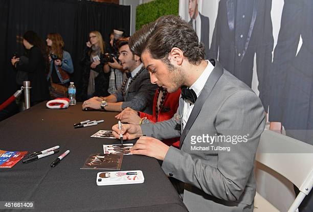 Singer Gianluca Ginoble of Il Vilo signs an autograph for a fan at the unveiling of the HGTV Holiday House at Santa Monica Place on November 23 2013...