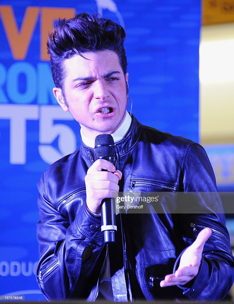 Singer Gianluca Ginoble of ll Volo performs at jetBlue Terminal 5 at JFK Airport on December 4, 2012 in New York City.