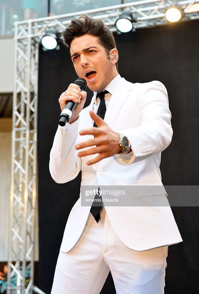 Singer <a gi-track='captionPersonalityLinkClicked' href=/galleries/search?phrase=Gianluca+Ginoble&family=editorial&specificpeople=5945022 ng-click='$event.stopPropagation()'>Gianluca Ginoble</a> of the group Il Volo performs onstage before signing copies of their new album 'We Are Love' at Santa Monica Place on June 12, 2013 in Santa Monica, California.