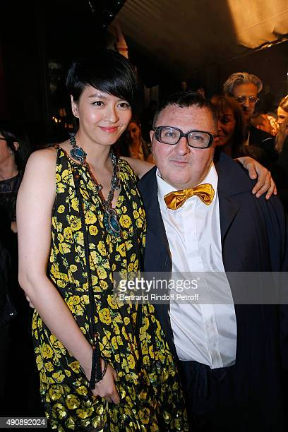 Singer Gigi Leung and Fashion Designer Alber Elbaz pose after the Lanvin show as part of the Paris Fashion Week Womenswear Spring/Summer 2016 on...