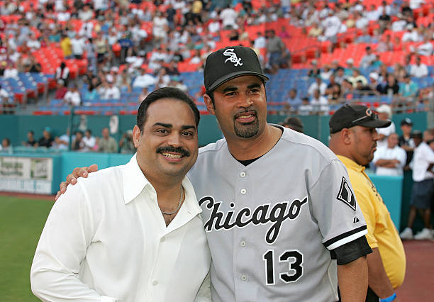84ce176d50e ... Authentic Jersey Chicago White Sox Singer Gilberto Santa Rosa poses  with Chicago White Sox manager Ozzie Guillen at the Marlins vs ...