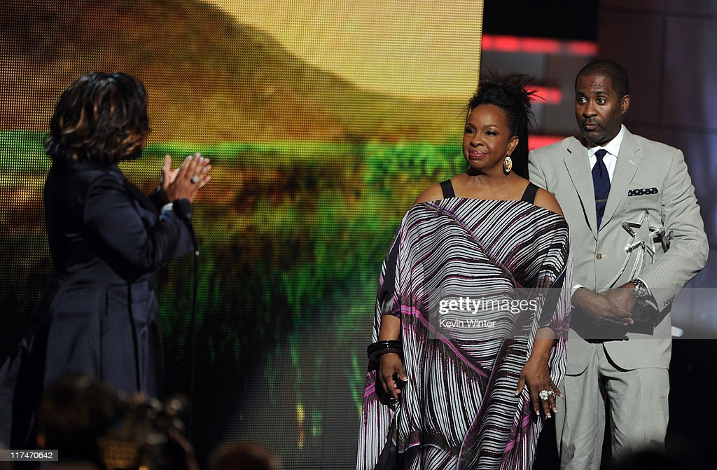 Singer Gladys Knight (C) presents the Lifetime Achievement Award to Patti LaBelle with her son Zuri Edwards onstage during the BET Awards '11 held at the Shrine Auditorium on June 26, 2011 in Los Angeles, California.