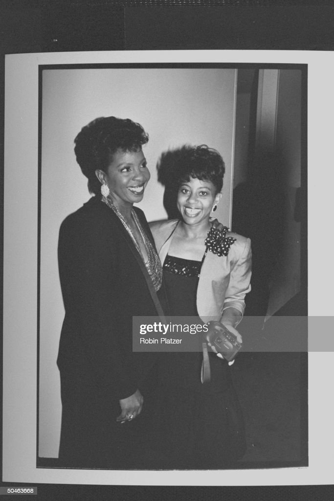 Singer Gladys Knight standing arm-in-arm w. her daughter Kenya, whose holding a Canon auto-focus camera during Dionne Warwick's four-day benefit to raise money for the Warwick Foundation's fund for AIDS education and pediatric AIDS care.