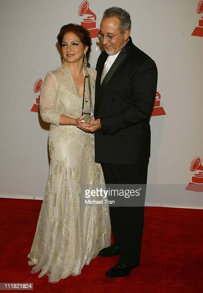 Singer Gloria Estefan and her husband Emilio Estefan pose with her 2008 Latin Recording Academy Person of the Year awards as she arrives for the...