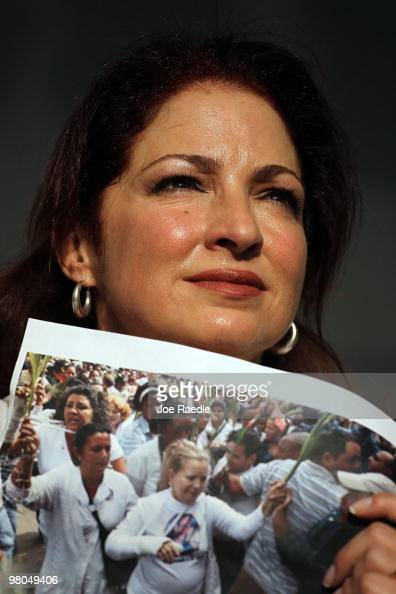 Singer Gloria Estefan holds a photograph of Cuba's Las Damas de Blanco as she shows her support for them on March 25 2010 in Miami Florida In Cuba...