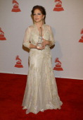 Singer Gloria Estefan poses with her 2008 Latin Recording Academy Person of the Year awards as she arrives for the event in her honor at the George R...
