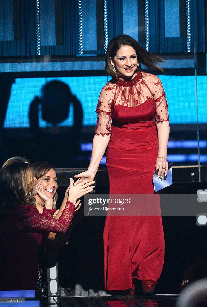 Singer <a gi-track='captionPersonalityLinkClicked' href=/galleries/search?phrase=Gloria+Estefan&family=editorial&specificpeople=201703 ng-click='$event.stopPropagation()'>Gloria Estefan</a> walks onstage during the 56th GRAMMY Awards at Staples Center on January 26, 2014 in Los Angeles, California.