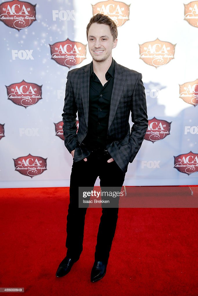 Singer <a gi-track='captionPersonalityLinkClicked' href=/galleries/search?phrase=Greg+Bates&family=editorial&specificpeople=9092143 ng-click='$event.stopPropagation()'>Greg Bates</a> arrives at the American Country Awards 2013 at the Mandalay Bay Events Center on December 10, 2013 in Las Vegas, Nevada.