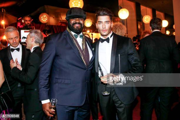 US singer Gregory Porter and influencer Toni Mahfud attend the GQ Men of the year Award 2017 after show party at Komische Oper on November 9 2017 in...