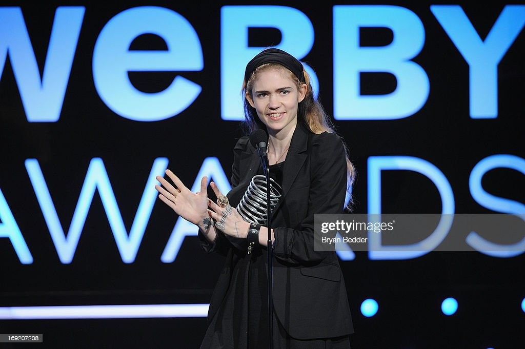Singer Grimes speaks onstage at the 17th Annual Webby Awards at Cipriani Wall Street on May 21, 2013 in New York City.