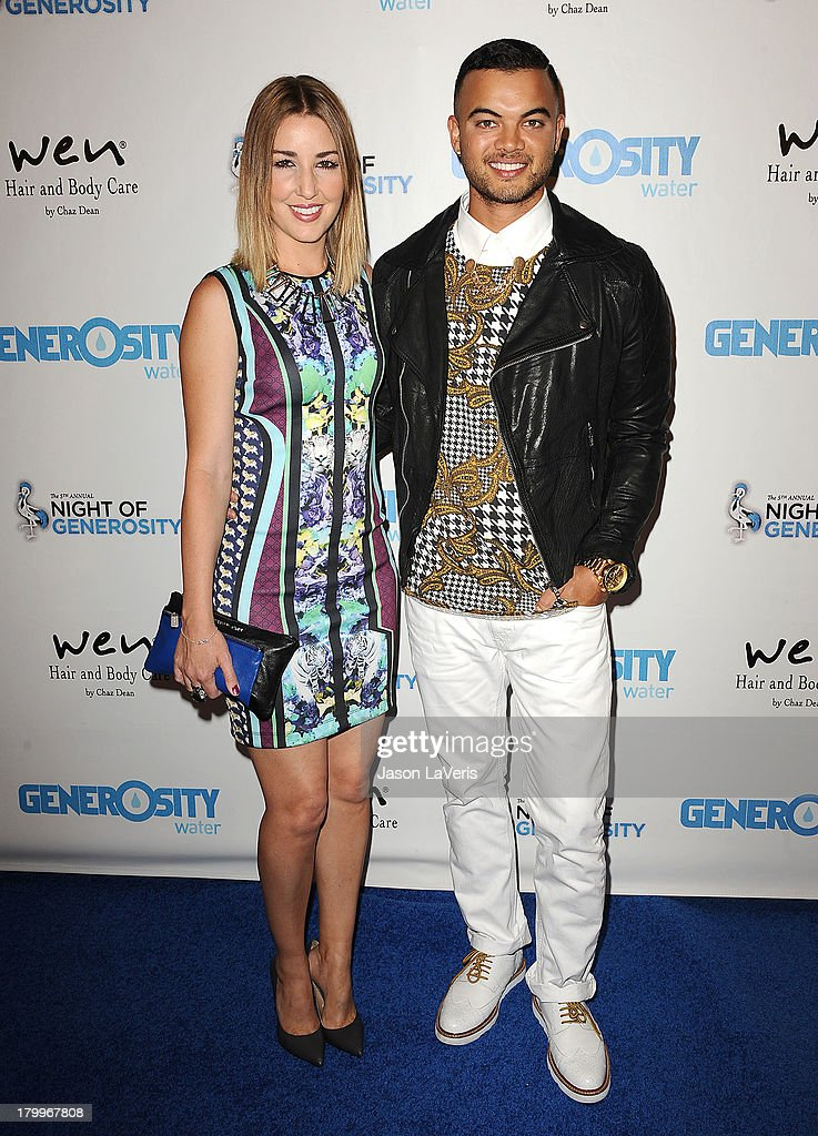 Singer Guy Sebastian (R) and wife Jules Egan attend Generosity Water's 5th annual Night of Generosity benefit at Beverly Hills Hotel on September 6, 2013 in Beverly Hills, California.