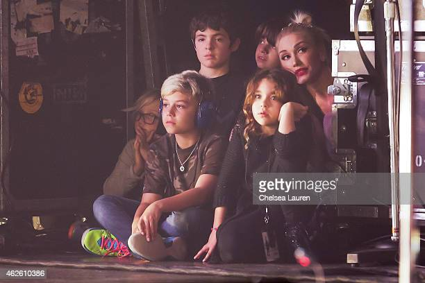 Singer Gwen Stefani and her children look on as musician Bush performs at The Wiltern on January 31 2015 in Los Angeles California