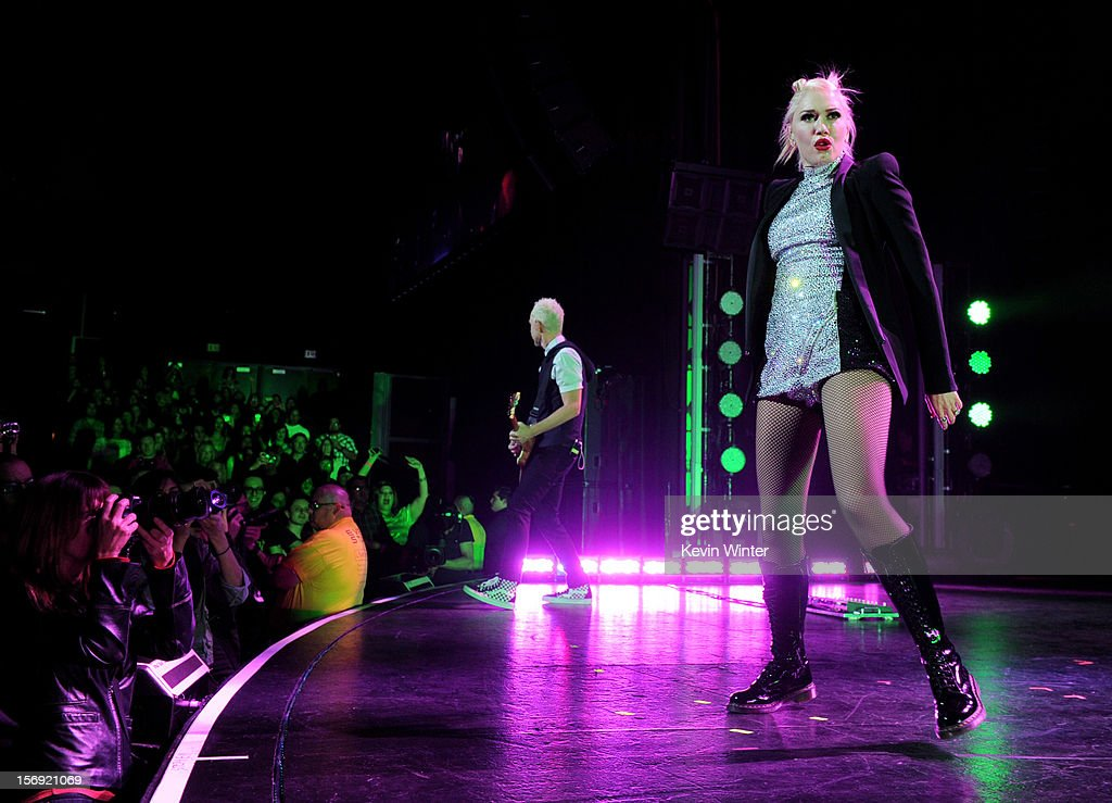 Singer Gwen Stefani (R) and musician Tom Dumont of No Doubt perform at Gibson Amphitheatre on November 24, 2012 in Universal City, California.