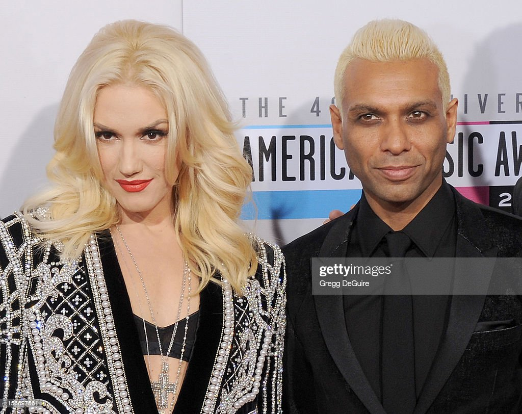 Singer Gwen Stefani and musician Tony Kanal of No Doubt arrive at the 40th Anniversary American Music Awards at Nokia Theatre L.A. Live on November 18, 2012 in Los Angeles, California.